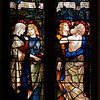 "Christ's Resurrection and Ascension Stained Glass Window by Henry Holiday <br><br> Henry Holiday (1839-1927) was an English historical genre and landscape painter, stained glass designer, illustrator, and sculptor. He is considered to be a member of the Pre-Raphaelite school of art, according to <a href=""http://en.wikipedia.org/wiki/Henry_Holiday"">Wikipedia.</a> <br><br> Holiday was born in London and at age 15 was admitted to the Royal Academy. Through his friendship with several artists there, he was introduced to artists of the ""Pre-Raphaelite Brotherhood"". This movement was to be pivotal in his future artistic and political life. From Wikipedia: ""The group's intention was to reform art by rejecting what it considered the mechanistic approach first adopted by Mannerist artists who succeeded Raphael and Michelangelo. Its members believed the Classical poses and elegant compositions of Raphael in particular had been a corrupting influence on the academic teaching of art, hence the name ""Pre-Raphaelite""."" <br><br> In 1861, Holiday accepted the job of stained glass window designer for Powell's Glass Works. During his time there he fulfilled over 300 commissions, mostly for customers in the U.S. He left in 1891 to set up his own glass works in Hampstead, producing stained glass, mosaics, enamels and sacerdotal objects. <br><br> Holiday's stained glass work can be found all over Britain and some of his best is at Westminster Abbey according to Wikipedia. In addition to his stained glass work, Holiday was a painter; his works include The Burgess of Calais, The Rhine Maiders, Dante and Beatrice. He was commissioned by Lewis Carroll to illustrate The Hunting of the Snark. He remained friends with the author throughout his life."