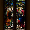 "Christian Nurturing by Henry Holiday <br><br> This window embodies the ideals of parental and Christian nurturing. In the lower portion, Jacob blesses his children. In the upper portion of the window, Christ gives His commission to Saint Peter. <br><br> Henry Holiday (1839-1927) was an English historical genre and landscape painter, stained glass designer, illustrator, and sculptor. He is considered to be a member of the Pre-Raphaelite school of art, according to <a href=""http://en.wikipedia.org/wiki/Henry_Holiday"">Wikipedia.</a> <br><br> Holiday was born in London and at age 15 was admitted to the Royal Academy. Through his friendship with several artists there, he was introduced to artists of the ""Pre-Raphaelite Brotherhood"". This movement was to be pivotal in his future artistic and political life. From Wikipedia: ""The group's intention was to reform art by rejecting what it considered the mechanistic approach first adopted by Mannerist artists who succeeded Raphael and Michelangelo. Its members believed the Classical poses and elegant compositions of Raphael in particular had been a corrupting influence on the academic teaching of art, hence the name ""Pre-Raphaelite""."" <br><br> In 1861, Holiday accepted the job of stained glass window designer for Powell's Glass Works. During his time there he fulfilled over 300 commissions, mostly for customers in the U.S. He left in 1891 to set up his own glass works in Hampstead, producing stained glass, mosaics, enamels and sacerdotal objects.  Holiday's stained glass work can be found all over Britain and some of his best is at Westminster Abbey according to Wikipedia. <br><br> In addition to his stained glass work, Holiday was a painter; his works include The Burgess of Calais, The Rhine Maiders, Dante and Beatrice. He was commissioned by Lewis Carroll to illustrate The Hunting of the Snark. He remained friends with the author throughout his life."