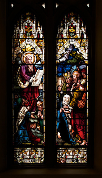 "Moses and the Law by Heaton, Butler, and Bayne <br><br> This is an Old Testament window, the lower portion  shows Moses giving the Law. <br><br> Clement Heaton originally founded his stained glass firm in 1852, joined by James Butler in 1855. Between 1859-61 they worked alongside Clayton and Bell and were joined by Robert Turnill Bayne, who became their sole designer and a full partner in the firm from 1862. His windows show strong design and color, and are often recognizable by the inclusion of at least one figure with Bayne's features and long beard to <a href=""http://en.wikipedia.org/wiki/Heaton,_Butler_and_Bayne"">Wikipedia.</a>. They established their studio in Covent Garden, London, and went on to become one of the leading firms of Gothic Revival stained glass manufacturers, whose work was commissioned by the principal Victorian architects. A change in direction came with their production of windows to the designs of Henry Holiday in 1868, which show a more classical influence at work. During a long career, the firm produced stained glass for numerous churches throughout the U.K. and the U.S. <br><br> During the Medieval period, from the Norman Conquest of England in 1066 until the 1530s, much stained glass was produced and installed in churches, monasteries and cathedrals. Two historic events had brought an end to this and the destruction of most of the glass-the Dissolution of the Monasteries under Henry VIII and the Puritan era under Oliver Cromwell in the 17th century. <br><br> The early 19th century was marked by a renewal of the Christian faith, a growth of Roman Catholicism, a planting of new churches, particularly in centers of industrial growth and the restoration of many ancient churches and cathedrals. In the 1850s a number of young designers worked in conjunction with the leading Gothic Revival architects in the provision of stained glass for new churches and for the restoration of old; the work of John Richard Clayton, Alfred Bell, Clement Heaton, James Butler, Robert Bayne, can be found in Incarnation."