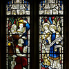 "The Church of the Incarnation Chapel of the Nativity Window  by C.E. Kempe <br><br> The Chapel of the Nativity was given by the Constable family, founders of the Arnold Constable department store. The windows and the altarpiece were purchased from a private family chapel in England. Kempe also made the Great West Window in the church.   <br><br> C.E. Kemp (1837-1907) came from a well-off family; his uncle was a successful property developer and politician in nearby Brighton, and his grandfather was Lord Mayor of London, according to   <a href=""http://www.britainexpress.com/History/bio/Kempe.htm"">British Express. </a> <br><br> He considered the priesthood, but his severe stammer which was an impediment to preaching. Instead Kempe decided that ""if I was not permitted to minister in the Sanctuary I would use my talents to adorn it"", and subsequently went to study architecture with the firm of a leading ecclesiastical architect George Frederick Bodley, where he learned the aesthetic principles of medieval church art particularly stain glass, according to  <a href=""http://en.wikipedia.org/wiki/Charles_Eamer_Kempe"">Wikipedia.</a> From Britain Express: ""Kempe travelled around Britain and overseas, sketching medieval window designs. Kempe assisted Bodley on two major church projects in the 1860s; All Saints, Cambridge, and St John's, Liverpool. In 1866 the important stained glass makers Clayton and Bell asked Kempe to design a memorial window for Bishop Hooper in Gloucester Cathedral.  <br><br> In 1866 he started his own business in London. Kempe Studios began by supplying vestments, stained glass, and church furnishings. The studio was a success, and enjoyed continual growth throughout the late Victorian period. You could say that he was fortunate, for Kempe Studios began in a period when church architecture and rebuilding was in vogue; the spiritual Renaissance of the Victorian period led to many medieval churches being rebuilt. So suppliers of materials and architectural knowledge were in great demand, and Kempe's work, particularly with stained glass, found a ready market of buyers. <br><br> Kempe decided early on that he needed to use a trademark, and he chose a wheatsheaf, which appears in the Kempe family coat of arms. Finding the wheatsheaf in a set of Kempe windows is a strangely enjoyable pastime for people who enjoy exploring Victorian churches! Kempe was especially active in his native Sussex, where fully 116 churches boast examples of his work. He did not just deal in stained glass, though it is for glass that Kempe is best known. Some of his most important work was with wall painting, such as that at Staplefield, outside Horsham, West Sussex. Aside from the wheatsheaf trademark, one of the characteristic features of a Kempe design is a strong predominence of yellow. <br><br> Kempe's designs - particularly those in stained glass - helped define the style of an age, closely associated with the artwork of the Pre-Raphaelites. When you see a Victorian stained glass window, with its clear, clean colours and romanticised figures, you may not be seeing a Kempe design, but you are almost certainly seeing a design influenced by Kempe. <br><br> Kempe died in 1907, and his company was taken over by WE Tower. But Tower did not enjoy the same success as Kempe, and the company folded in 1934. <br><br> Kempe never married; he was a shy man by nature, though he enjoyed entertaining guests at the house he purchased at Lindfield, West Sussex. He is buried in the churchyard at Ovingdean, the place of his birth."" <br><br> Kempe studios produced over 4,000 stained glass windows."