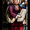 "Moses and the Law by Heaton, Butler and Bayne <br><br> This is an Old Testament window, the lower portion  shows Moses giving the Law. <br><br> Clement Heaton originally founded his stained glass firm in 1852, joined by James Butler in 1855. Between 1859-61 they worked alongside Clayton and Bell and were joined by Robert Turnill Bayne, who became their sole designer and a full partner in the firm from 1862. His windows show strong design and color, and are often recognizable by the inclusion of at least one figure with Bayne's features and long beard to <a href=""http://en.wikipedia.org/wiki/Heaton,_Butler_and_Bayne"">Wikipedia.</a>. They established their studio in Covent Garden, London, and went on to become one of the leading firms of Gothic Revival stained glass manufacturers, whose work was commissioned by the principal Victorian architects. A change in direction came with their production of windows to the designs of Henry Holiday in 1868, which show a more classical influence at work. During a long career, the firm produced stained glass for numerous churches throughout the U.K. and the U.S.  During the Medieval period, from the Norman Conquest of England in 1066 until the 1530s, much stained glass was produced and installed in churches, monasteries and cathedrals. Two historic events had brought an end to this and the destruction of most of the glass-the Dissolution of the Monasteries under Henry VIII and the Puritan era under Oliver Cromwell in the 17th century. <br><br> The early 19th century was marked by a renewal of the Christian faith, a growth of Roman Catholicism, a planting of new churches, particularly in centers of industrial growth and the restoration of many ancient churches and cathedrals. In the 1850s a number of young designers worked in conjunction with the leading Gothic Revival architects in the provision of stained glass for new churches and for the restoration of old; the work of John Richard Clayton, Alfred Bell, Clement Heaton, James Butler, Robert Bayne, can be found in Incarnation."