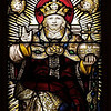 "The Church of the Incarnation Great West Window by C.E. Kempe <br><br> The great west window above the main entrance to the nave depicts the Adoration of the Lord as the Risen and Enthroned Christ in Heaven with a gathering of saints and angels. This window echoes the style of fifteenth-century English glass painters and was made by C.E. Kemp of England. Kemp also made the windows in the Chapel of the Nativity. <br><br> C.E. Kemp (1837-1907) came from a well-off family; his uncle was a successful property developer and politician in nearby Brighton, and his grandfather was Lord Mayor of London, according to   <a href=""http://www.britainexpress.com/History/bio/Kempe.htm"">British Express. </a> <br><br> He considered the priesthood, but his severe stammer which was an impediment to preaching. Instead Kempe decided that ""if I was not permitted to minister in the Sanctuary I would use my talents to adorn it"", and subsequently went to study architecture with the firm of a leading ecclesiastical architect George Frederick Bodley, where he learned the aesthetic principles of medieval church art particularly stain glass, according to  <a href=""http://en.wikipedia.org/wiki/Charles_Eamer_Kempe"">Wikipedia.</a> From Britain Express: ""Kempe travelled around Britain and overseas, sketching medieval window designs. Kempe assisted Bodley on two major church projects in the 1860s; All Saints, Cambridge, and St John's, Liverpool. In 1866 the important stained glass makers Clayton and Bell asked Kempe to design a memorial window for Bishop Hooper in Gloucester Cathedral.  <br><br> In 1866 he started his own business in London. Kempe Studios began by supplying vestments, stained glass, and church furnishings. The studio was a success, and enjoyed continual growth throughout the late Victorian period. You could say that he was fortunate, for Kempe Studios began in a period when church architecture and rebuilding was in vogue; the spiritual Renaissance of the Victorian period led to many medieval churches being rebuilt. So suppliers of materials and architectural knowledge were in great demand, and Kempe's work, particularly with stained glass, found a ready market of buyers. <br><br> Kempe decided early on that he needed to use a trademark, and he chose a wheatsheaf, which appears in the Kempe family coat of arms. Finding the wheatsheaf in a set of Kempe windows is a strangely enjoyable pastime for people who enjoy exploring Victorian churches! Kempe was especially active in his native Sussex, where fully 116 churches boast examples of his work. He did not just deal in stained glass, though it is for glass that Kempe is best known. Some of his most important work was with wall painting, such as that at Staplefield, outside Horsham, West Sussex. Aside from the wheatsheaf trademark, one of the characteristic features of a Kempe design is a strong predominence of yellow. <br><br> Kempe's designs - particularly those in stained glass - helped define the style of an age, closely associated with the artwork of the Pre-Raphaelites. When you see a Victorian stained glass window, with its clear, clean colours and romanticised figures, you may not be seeing a Kempe design, but you are almost certainly seeing a design influenced by Kempe. <br><br> Kempe died in 1907, and his company was taken over by WE Tower. But Tower did not enjoy the same success as Kempe, and the company folded in 1934.  Kempe never married; he was a shy man by nature, though he enjoyed entertaining guests at the house he purchased at Lindfield, West Sussex. He is buried in the churchyard at Ovingdean, the place of his birth."" <br><br> Kempe studios produced over 4,000 stained glass windows."