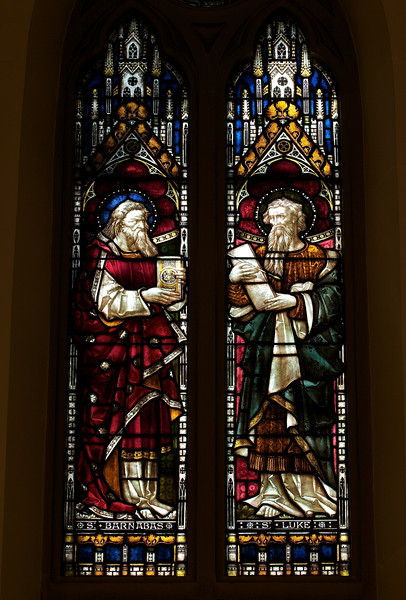 "Saint Paul on Mars Hill by Clayton & Bell, London <br><br> This is a New Testament window representing the spread of the Gospel. Saint Paul is seen preaching on Mars Hill. Shown above him are Saint Luke and Saint Barnabas, Paul's companions. <br><br> Clayton and Bell was one of the most prolific and proficient workshops of English stained glass during the latter half of the 19th century, according to <a href=""http://en.wikipedia.org/wiki/Clayton_and_Bell"">Wikipedia.</a> The partners were John Richard Clayton (London, 1827–1913) and Alfred Bell (Silton, Dorset, 1832–95). The company was founded in 1855 and continued until 1993. Their windows are found throughout the U.K., U.S., Canada, Australia and New Zealand. <br><br> During the Medieval period, from the Norman Conquest of England in 1066 until the 1530s, much stained glass was produced and installed in churches, monasteries and cathedrals. Two historic events had brought an end to this and the destruction of most of the glass-the Dissolution of the Monasteries under Henry VIII and the Puritan era under Oliver Cromwell in the 17th century. <br><br> The early 19th century was marked by a renewal of the Christian faith, a growth of Roman Catholicism, a planting of new churches, particularly in centers of industrial growth and the restoration of many ancient churches and cathedrals. In the 1850s a number of young designers worked in conjunction with the leading Gothic Revival architects in the provision of stained glass for new churches and for the restoration of old; the work of John Richard Clayton, Alfred Bell, Clement Heaton, James Butler, Robert Bayne, can be found in Incarnation.  Initially Clayton and Bell's designs were manufactured by Heaton and Butler, with whom they shared a studio between 1859 and 1862, employing the very talented Robert Bayne as a designer as well. From 1861 Clayton and Bell commenced manufacturing their own glass. Robert Bayne became part of the partnership with Heaton and Butler, forming the firm Heaton, Butler and Bayne.  <br><br> There was a good deal of interaction and influence between Clayton and Bell, and Heaton, Butler and Bayne. The windows of both firms share several distinguishing features and characteristic color-combinations, which are uncommon in other designers. <br><br> Clayton and Bell moved into large premises in Regent Street, London, where they employed about 300 people. In the late 1860s and 1870s the firm was at its busiest, and employees worked night shifts in order to fulfill commissions. <br><br> After the deaths of Alfred Bell in 1895 and John Richard Clayton in 1913, the firm continued under Bell's son, John Clement Bell (1860–1944), then under Reginald Otto Bell (1884–1950) and lastly Michael Farrar-Bell (1911–93) until his death <br><br> Clayton and Bell was awarded a Royal Warrant (Royal warrants of appointment have been issued for centuries to tradespeople who supply goods or services to a royal court or certain royal personages. The royal warrant enables the supplier to advertise the fact that they supply to the issuer of the royal warrant, so lending prestige to the supplier) by the Queen in 1883.  <br><br> According to commentary in Wikipedia, Clayton and Bell windows are typified by their brilliant luminosity. In 1863 John Richard Clayton was among those who was experimenting with the manufacture of so-called pot metal or colored glass produced by simple ancient manufacturing techniques which brought about great variability in the texture and color of glass which is characteristic of ancient windows. <br><br> ""Clayton and Bell were familiar with both ancient windows and with the various artistic movements of their time, such as the Pre-Raphaelite Brotherhood. Their work shows the influence, but not the dominance of either. It is, rather, an elegant synthesis of archaeologically sourced details, such as their characteristic brightly coloured canopies which are of a 14th century style, with figures who pay passing homage to the medieval in their sweeping robes of strong bright colours, a surety and refinement of the painted details and an excellence of design which never fails to integrate the structural lines of the lead into the overall picture."""