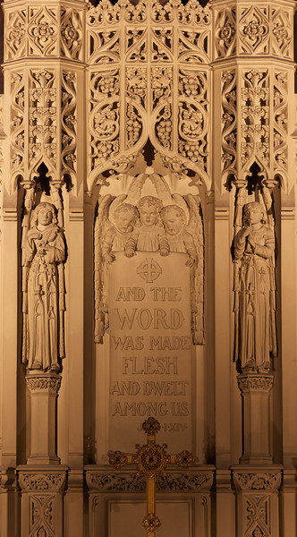 """Incarnation Church Reredos<br /> <br /> The reredos is made of caenstone. Its three cherubim hold a banner bearing the words """"And the Word was made flesh and dwelt among us."""""""