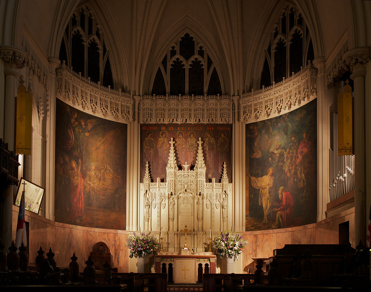 """Incarnation Altar by S. Klaber & Company, Central Mural by Henry Wynd Young, Side Murals by John LaFarge <br><br> S. Klaber & Company made the marble altar from a design by Heins and La Farge, architects according to the <a href=""""http://www.churchoftheincarnation.org/about-incarnation/landmark-building/the-window-tour/altar-and-chancel/"""">Incarnation website.</a> <br><br> """"The design incorporates many types of marble from different areas of the world, including Vermont, Georgia, Belgium, Africa, Italy, and France. The altar cross is bronze covered with a dull rose gold. The cross is richly ornamented in Gothic style with grapevine motifs symbolizing the blood of Christ. It is studded with garnets and amethysts. The cross and candlesticks were made by Gorham & Company. <br><br> The reredos is made of caenstone. Its three cherubim hold a banner bearing the words And the Word was made flesh and dwelt among us. On either side of the scroll, four angels rejoice at this Incarnation message and play musical instruments in celebration. A central mural, above the reredos, continues the theme of an angel choir. They are singing Gloria in excelsis Deo. The mural is by Henry Wynd Young. On either side of the central mural are two murals by John La Farge, who painted them in situ. They depict the Adoration of the Magi at the manger in Bethlehem."""""""