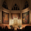 "Incarnation Altar by S. Klaber & Company, Central Mural by Henry Wynd Young, Side Murals by John LaFarge <br><br> S. Klaber & Company made the marble altar from a design by Heins and La Farge, architects according to the <a href=""http://www.churchoftheincarnation.org/about-incarnation/landmark-building/the-window-tour/altar-and-chancel/"">Incarnation website.</a> <br><br> ""The design incorporates many types of marble from different areas of the world, including Vermont, Georgia, Belgium, Africa, Italy, and France. The altar cross is bronze covered with a dull rose gold. The cross is richly ornamented in Gothic style with grapevine motifs symbolizing the blood of Christ. It is studded with garnets and amethysts. The cross and candlesticks were made by Gorham & Company. <br><br> The reredos is made of caenstone. Its three cherubim hold a banner bearing the words And the Word was made flesh and dwelt among us. On either side of the scroll, four angels rejoice at this Incarnation message and play musical instruments in celebration. A central mural, above the reredos, continues the theme of an angel choir. They are singing Gloria in excelsis Deo. The mural is by Henry Wynd Young. On either side of the central mural are two murals by John La Farge, who painted them in situ. They depict the Adoration of the Magi at the manger in Bethlehem."""