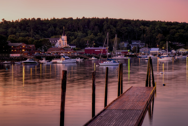Boothbay Harbor, August 17, 2011, 5:36 am<br /> <br /> Early morning light bathes Boothbay Harbor. The church is Our Lady Queen of Peace Catholic Church. 55 mm (88 mm with 1.6X crop factor), f10, 6 seconds, 100 ISO.
