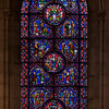 The Riverside Church International Stained Glass Window<br /> <br /> Stained glass windows at Riverside Church are in the tradition of Chartres Cathedral in France and made in the U.S. and France. Many subjects of the aisle windows relate directly to modern history, such as the Declaration of Independence and the Emancipation Proclamation, treated in the Gothic spirit. Other windows celebrate the accomplishments of Aristotle, Socrates, John Calvin, and Roger Williams. I haven't been able to find the names of the artists that created the windows.<br /> <br /> There are ten aisle windows with the west aisle windows representing the following themes: Agriculture, Reformers, Bible, State, and Builders with the east windows representing International, Humanity, Scholars, Music, and Children. The aisle clerestory windows (upper windows) symbolize the communication of God with humanity through Jesus Christ, according to the church publication I referenced in the first photo.