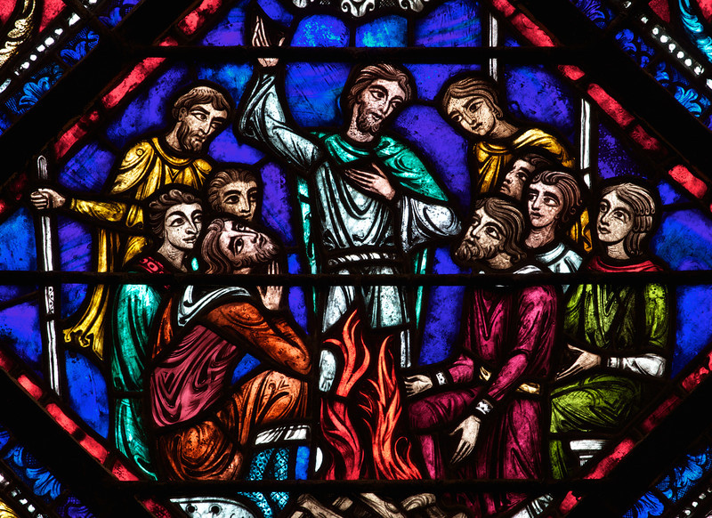 Panel from Bible Window at Riverside Church<br /> <br /> Stained glass windows at Riverside Church are in the tradition of Chartres Cathedral in France and made in the U.S. and France. Many subjects of the aisle windows relate directly to modern history, such as the Declaration of Independence and the Emancipation Proclamation, treated in the Gothic spirit. Other windows celebrate the accomplishments of Aristotle, Socrates, John Calvin, and Roger Williams. I haven't been able to find the names of the artists that created the windows.<br /> <br /> There are ten aisle windows with the west aisle windows representing the following themes: Agriculture, Reformers, Bible, State, and Builders with the east windows representing International, Humanity, Scholars, Music, and Children. The aisle clerestory windows (upper windows) symbolize the communication of God with humanity through Jesus Christ, according to the church publication I referenced in the first photo.