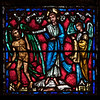 Panel from Humanity Window at The Riverside Church<br /> <br /> Stained glass windows at Riverside Church are in the tradition of Chartres Cathedral in France and made in the U.S. and France. Many subjects of the aisle windows relate directly to modern history, such as the Declaration of Independence and the Emancipation Proclamation, treated in the Gothic spirit. Other windows celebrate the accomplishments of Aristotle, Socrates, John Calvin, and Roger Williams. I haven't been able to find the names of the artists that created the windows.<br /> <br /> There are ten aisle windows with the west aisle windows representing the following themes: Agriculture, Reformers, Bible, State, and Builders with the east windows representing International, Humanity, Scholars, Music, and Children. The aisle clerestory windows (upper windows) symbolize the communication of God with humanity through Jesus Christ, according to the church publication I referenced in the first photo.