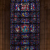 The Riverside Church Humanity Stained Glass Window<br /> <br /> Stained glass windows at Riverside Church are in the tradition of Chartres Cathedral in France and made in the U.S. and France. Many subjects of the aisle windows relate directly to modern history, such as the Declaration of Independence and the Emancipation Proclamation, treated in the Gothic spirit. Other windows celebrate the accomplishments of Aristotle, Socrates, John Calvin, and Roger Williams. I haven't been able to find the names of the artists that created the windows.<br /> <br /> There are ten aisle windows with the west aisle windows representing the following themes: Agriculture, Reformers, Bible, State, and Builders with the east windows representing International, Humanity, Scholars, Music, and Children. The aisle clerestory windows (upper windows) symbolize the communication of God with humanity through Jesus Christ, according to the church publication I referenced in the first photo.