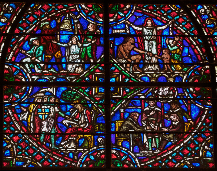 Panel from State Window at Riverside Church<br /> <br /> Stained glass windows at Riverside Church are in the tradition of Chartres Cathedral in France and made in the U.S. and France. Many subjects of the aisle windows relate directly to modern history, such as the Declaration of Independence and the Emancipation Proclamation, treated in the Gothic spirit. Other windows celebrate the accomplishments of Aristotle, Socrates, John Calvin, and Roger Williams. I haven't been able to find the names of the artists that created the windows.<br /> <br /> There are ten aisle windows with the west aisle windows representing the following themes: Agriculture, Reformers, Bible, State, and Builders with the east windows representing International, Humanity, Scholars, Music, and Children. The aisle clerestory windows (upper windows) symbolize the communication of God with humanity through Jesus Christ, according to the church publication I referenced in the first photo.