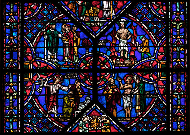 Panel from Reformers Window at Riverside Church<br /> <br /> Stained glass windows at Riverside Church are in the tradition of Chartres Cathedral in France and made in the U.S. and France. Many subjects of the aisle windows relate directly to modern history, such as the Declaration of Independence and the Emancipation Proclamation, treated in the Gothic spirit. Other windows celebrate the accomplishments of Aristotle, Socrates, John Calvin, and Roger Williams. I haven't been able to find the names of the artists that created the windows.<br /> <br /> There are ten aisle windows with the west aisle windows representing the following themes: Agriculture, Reformers, Bible, State, and Builders with the east windows representing International, Humanity, Scholars, Music, and Children. The aisle clerestory windows (upper windows) symbolize the communication of God with humanity through Jesus Christ, according to the church publication I referenced in the first photo.