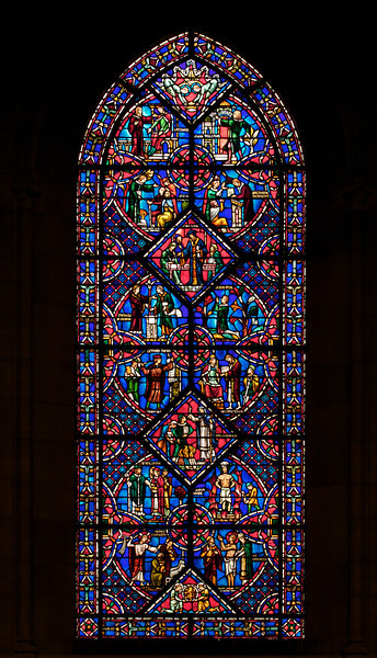 Riverside Church Reformers Stained Glass Window<br /> <br /> Stained glass windows at Riverside Church are in the tradition of Chartres Cathedral in France and made in the U.S. and France. Many subjects of the aisle windows relate directly to modern history, such as the Declaration of Independence and the Emancipation Proclamation, treated in the Gothic spirit. Other windows celebrate the accomplishments of Aristotle, Socrates, John Calvin, and Roger Williams. I haven't been able to find the names of the artists that created the windows.<br /> <br /> There are ten aisle windows with the west aisle windows representing the following themes: Agriculture, Reformers, Bible, State, and Builders with the east windows representing International, Humanity, Scholars, Music, and Children. The aisle clerestory windows (upper windows) symbolize the communication of God with humanity through Jesus Christ, according to the church publication I referenced in the first photo.
