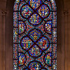 Riverside Church Music Stained Glass Window<br /> <br /> Stained glass windows at Riverside Church are in the tradition of Chartres Cathedral in France and made in the U.S. and France. Many subjects of the aisle windows relate directly to modern history, such as the Declaration of Independence and the Emancipation Proclamation, treated in the Gothic spirit. Other windows celebrate the accomplishments of Aristotle, Socrates, John Calvin, and Roger Williams. I haven't been able to find the names of the artists that created the windows.<br /> <br /> There are ten aisle windows with the west aisle windows representing the following themes: Agriculture, Reformers, Bible, State, and Builders with the east windows representing International, Humanity, Scholars, Music, and Children. The aisle clerestory windows (upper windows) symbolize the communication of God with humanity through Jesus Christ, according to the church publication I referenced in the first photo.