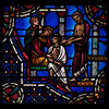 Panel from Scholars Window at Riverside Church<br /> <br /> Stained glass windows at Riverside Church are in the tradition of Chartres Cathedral in France and made in the U.S. and France. Many subjects of the aisle windows relate directly to modern history, such as the Declaration of Independence and the Emancipation Proclamation, treated in the Gothic spirit. Other windows celebrate the accomplishments of Aristotle, Socrates, John Calvin, and Roger Williams. I haven't been able to find the names of the artists that created the windows.<br /> <br /> There are ten aisle windows with the west aisle windows representing the following themes: Agriculture, Reformers, Bible, State, and Builders with the east windows representing International, Humanity, Scholars, Music, and Children. The aisle clerestory windows (upper windows) symbolize the communication of God with humanity through Jesus Christ, according to the church publication I referenced in the first photo.