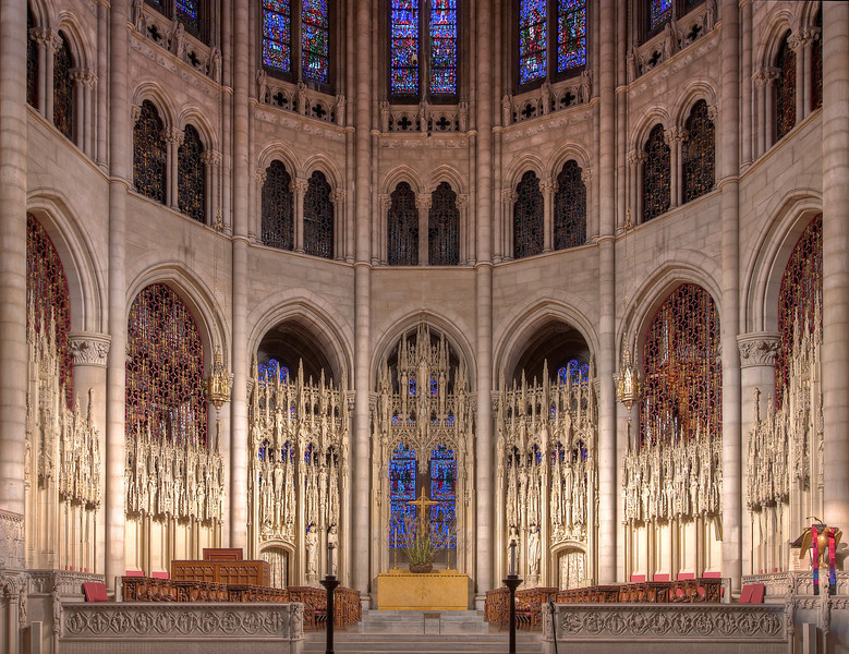 "The Riverside Church Chancel Screen<br /> <br /> From a Riverside Church pamphlet:<br /> <br /> ""The chancel screen is carved in white French Caen stone, filling seven arches above and behind the choir. The delicate tracery of this screen supports eighty figures of men and women who, through the ages, have been leading examples of specific aspects of the life of Christ. In each arch, a statue of Jesus is at the center. Moving from left to right, the panels contain figures in Physicians, Teachers, Prophets, Humanitarians, Missionaries, Reformers, and Lovers of Beauty. Included among them are Abraham Lincoln, Booker T. Washington, Florence Nightingale, Louis Pasteur, David Livingston, Martin Luther, Saint Francis, Socrates and man other historical and Biblical figures, This chancel screen and most of the stone carving at Riverside was done by the Piccirilli Brothers, working from their studio in New York City.<br /> <br /> With the exception of the chancel screen described above, most of the stone in the Nave is Indian limestone."" ""Native American oak is used throughout The Riverside Church. It is crafted into pews and here, in the chancel, it is intricately carved. The choir stalls, each unique, include numerous figures found in the Psalms. The oak railing before the choir stalls on the right is titled, ""I will sing unto the Lord"" and is inspired by Psalm 104. The wood carving in the church was crated by a team of Norwegian artists working in New York City."""