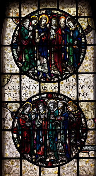 """Saints Stained Glass Window Designed by J. Gordon Guthrie, executed by Ernest Lastman, and Made by Henry Wynd Young Studio (1920) <br /> <br /> Top: Saints Thaddeus, Matthius, James the Less, Simon: the Apostles. <br /> <br /> Bottom: Saints Bartholomew, Philip, Andrew, Peter, James the Great, and John: the Apostles.<br /> <br /> The Cantlcle of Te Deum is one of the oldest hymns in the Church and is featured in seven windows on the north side of the nave. The light colored glass surrounding the circle is called grisaille glas, which is silvery tinted glass with floral patterns which allows more light to come through. <br /> <br /> I obtained information on the Saint Bartholomew's stained glass windows from """"Holy Light,"""" an excellent source of information by Becca Earley Richards, available at the Saint Bartholomew's bookstore."""