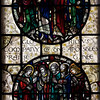 "Saints Stained Glass Window Designed by J. Gordon Guthrie, executed by Ernest Lastman, and Made by Henry Wynd Young Studio (1920) <br /> <br /> Top: Saints Thaddeus, Matthius, James the Less, Simon: the Apostles. <br /> <br /> Bottom: Saints Bartholomew, Philip, Andrew, Peter, James the Great, and John: the Apostles.<br /> <br /> The Cantlcle of Te Deum is one of the oldest hymns in the Church and is featured in seven windows on the north side of the nave. The light colored glass surrounding the circle is called grisaille glas, which is silvery tinted glass with floral patterns which allows more light to come through. <br /> <br /> I obtained information on the Saint Bartholomew's stained glass windows from ""Holy Light,"" an excellent source of information by Becca Earley Richards, available at the Saint Bartholomew's bookstore."