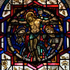 "The Crucifixion Stained Glass Window by J. Gordon Guthrie <br><br> John Gordon Guthrie (1874–1961), a Scottish immigrant, known professionally as ""J. Gordon Guthrie"" designed this window. Guthrie had first designed windows for Tiffany Studios. He left Tiffany in 1906 and worked for Duffner & Kimberly until 1914. The New York City company produced leaded glass and bronze lamps at approximately the same time as Tiffany. He then worked with Henry Wynd Young (1874–1923) until Young's death in 1923, when Guthrie took over the management of Young's studio. Guthrie began his own firm in 1925, and was active as a stained glass designer until his death on June 23, 1961, according to <a href=""http://en.wikipedia.org/wiki/Duffner_and_Kimberly "">Wikipedia.</a>"