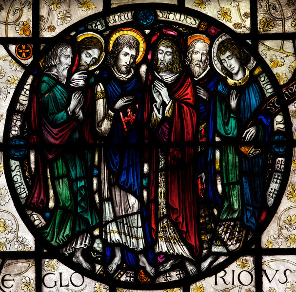 "Saints Stained Glass Window Designed by J. Gordon Guthrie, executed by Ernest Lastman, and Made by Henry Wynd Young Studio (1920)  <br><br> Saints Thaddeus, Matthius, James the Less, Simon: the Apostles.  <br><br> The Cantlcle of Te Deum is one of the oldest hymns in the Church and is featured in seven windows on the north side of the nave. The light colored glass surrounding the circle is called grisaille glas, which is silvery tinted glass with floral patterns which allows more light to come through.  <br><br> I obtained information on the Saint Bartholomew's stained glass windows from ""Holy Light,"" an excellent source of information by Becca Earley Richards, available at the Saint Bartholomew's bookstore."