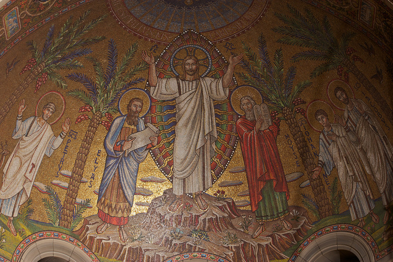 """Transfiguration of Christ"" Mosaic in the Apse above the Altar by Hildreth Meière <br><br> Hildreth Meière (1892-1961) was one of the most influential and creative decorative artists of the 20th century  and ranks with a small number of women artists whose achievements gained the recognition of the art world in the first half of the century according to the <a href=""http://www.hildrethmeiere.com""> International Hildreth Meiere Association website.</a>  She was born in New York  City. After studying in Florence and exposed to the Renaissance masters, she said ""After that I could not be satisfied with anything less than a big wall to paint on. I just had to be a mural painter,"" according to <a href=""http://en.wikipedia.org/wiki/Hildreth_Meiere""> Wikipedia.</a>  She continued her studies at the Art Students League of New York, the School of the Art Institute of Chicago, New York School of Applied Design for Women. She served as a draftsman in the U.S. Navy during World War I after training as a mapmaker. ""Her military service proved to be a valuable addition to her training for her career as a mural painter and designer,"" according to the Meière website.  <br><br> After the war, she was introduced to Bertram Goodhue, one of America's leading architects. Goodhue gave her the opportunity to paint the high altar for one of his church projects, Saint Mark's Episcopal Church in Mt. Kisco, New York. Afterward, she did most of the mural work for Goodhue's firm. <br><br> She next worked with Goodhue on the National Academy of Sciences building in Washington, D.C. He chose her to do the decorative mosaic work for the dome and arches in the Great Hall.  <br><br> Goodhue was selected the architect for the Nebraska state Capital in Lincoln. He gave her a great opportunity as the principal designer of the decorative art for the interior of the building to interpret the history and symbolism of the state of Nebraska. She received eight commissions over the next eight years to design the dome, ceilings, floors, and various spaces in the building.  <br><br> Meière received a Gold Medal from the Architectural League of New York in 1928 for her work on the Nebraska State Capital. This project was at the beginning of her career and established her as a leading designer of mural and mosaic work and interiors, according to the Meière website. <br><br> In 1928.1929, she had commissions to design interior mosaics for Temple Emanu-El and Saint Bartholomew's in New York City. For Saint Bartholomew's, she used glass mosaic for the ""Tranfiguration of Christ"" in the apse above the Altar.  <br><br> Meière served on the Citizen's Committee for the Army and Navy, providing altarpieces for military chaplains used on base camps, battleships, and hospitals worldwide.  <br><br> She served as President of the National Society of Mural Painters and the Liturgical arts Society, First Vice President of the Architectural League of New York (one of the first women members, she received its Gold Medal in Mural Painting in 1928), director of the Municipal Arts Society, and Associate of the National Academy of Design, and was appointed the first woman on the New York City Art Commission.  <br><br> Some of her work includes: <br><br> Mosaics for the Great Hall of the National Academy of Sciences, Washington, D.C.; Evolution-themed floor and ceiling art in Nebraska's State Capital, Lincoln, Nebraska; Saint Bartholomew's glass mosaic for the ""Transfiguration of Christ"" in the apse above the altar, New York City; 75-foot mosaic arch over the sanctuary, and mosaics surrounding the Torah-shaped bronze arc, Temple Emanu-El, New York City; Radio Center Music Hall building façade: three metal rondels called Song, Drama, and Dance; Washington National Cathedral, ""The Resurrected Christ"". <br><br> From the Meière website: <br><br> ""Hildreth Meière as an artist was a significant figure in several important areas of American visual culture.  First, she was most famous as an Art Deco muralist and decorator whose work stands among the most distinguished of her era.  Second, she is an important figure in the history of American Liturgical Art, and one of its most ecumenical practitioners.  Third, she is one of the preeminent mosaicists in the history of American art.  Finally, she is a woman artist who was able to gain the respect of the greatest muralists and architects of her day.  In 1956 she was the first woman honored with The Fine Arts Medal of the American Institute of Architects:  <br><br> A Master of Murals: the world of art might write your name high on the list of the great among our painters and write truly, but not fully.  Mosaic, terra cotta, leaded glass, metal, gesso -- these and still other media respond gratefully to the direction of your heart and hands.  Your collaboration with architects and other artists brings more than the addition of beauty; it transfuses the joint concept and makes it indivisible.  In accepting one more token, added to all the expressions of grateful appreciation your work has earned, you will permit us the realization that you are giving the institute the greater honor."" <br><br> She died in 1961. The requiem mass was held for her at Saint Vincent Ferrer Church in New York City, a church designed by Goodhue."