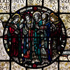 "Saints Stained Glass Window Designed by J. Gordon Guthrie, executed by Ernest Lastman, and Made by Henry Wynd Young Studio (1920)  <br><br> Saints Bartholomew, Philip, Andrew, Peter, James the Great, and John: the Apostles. <br><br> The Cantlcle of Te Deum is one of the oldest hymns in the Church and is featured in seven windows on the north side of the nave. The light colored glass surrounding the circle is called grisaille glas, which is silvery tinted glass with floral patterns which allows more light to come through.  <br><br> I obtained information on the Saint Bartholomew's stained glass windows from ""Holy Light,"" an excellent source of information by Becca Earley Richards, available at the Saint Bartholomew's bookstore."