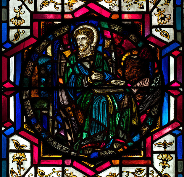 """Luke Stained Glass Window by J. Gordon Guthrie <br><br> John Gordon Guthrie (1874–1961), a Scottish immigrant, known professionally as """"J. Gordon Guthrie"""" designed this window. Guthrie had first designed windows for Tiffany Studios. He left Tiffany in 1906 and worked for Duffner & Kimberly until 1914. The New York City company produced leaded glass and bronze lamps at approximately the same time as Tiffany. He then worked with Henry Wynd Young (1874–1923) until Young's death in 1923, when Guthrie took over the management of Young's studio. Guthrie began his own firm in 1925, and was active as a stained glass designer until his death on June 23, 1961, according to <a href=""""http://en.wikipedia.org/wiki/Duffner_and_Kimberly """">Wikipedia.</a>"""