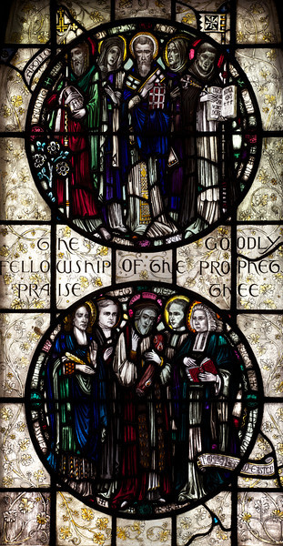 "Saints Stained Glass Window Designed by J. Gordon Guthrie, executed by Ernest Lastman, and Made by Henry Wynd Young Studio (1920) <br /> <br /> Top: Apollos (first century) North African missionary; Prophetess (1st century), one of the four daughters of Saint Phillip; Saint John Chrysotom (347-407), early Church Father; Savonarola (1452-1498); infamous Florentine monk who promoted the burning of secular art; Saint Dominic (1170-1221) founded the Dominican order. <br /> <br /> Bottom: James Bossuet (1627-1704), Bishop and orator under Louis XIV; Phillip Brooks (1835-1893), American Episcopal Bishop who wrote ""O Little Tow of Bethlehem""; Hugh Latimer (1485-1555), Protestant Bishop under Henry VIII; William Robertson (1721-1793), Scottish churchman and historian; George Whitfield (1714-1770), leader of the Calvinistic Methodist Church<br /> <br /> The Cantlcle of Te Deum is one of the oldest hymns in the Church and is featured in seven windows on the north side of the nave. The light colored glass surrounding the circle is called grisaille glas, which is silvery tinted glass with floral patterns which allows more light to come through. <br /> <br /> I obtained information on the Saint Bartholomew's stained glass windows from ""Holy Light,"" an excellent source of information by Becca Earley Richards, available at the Saint Bartholomew's bookstore."