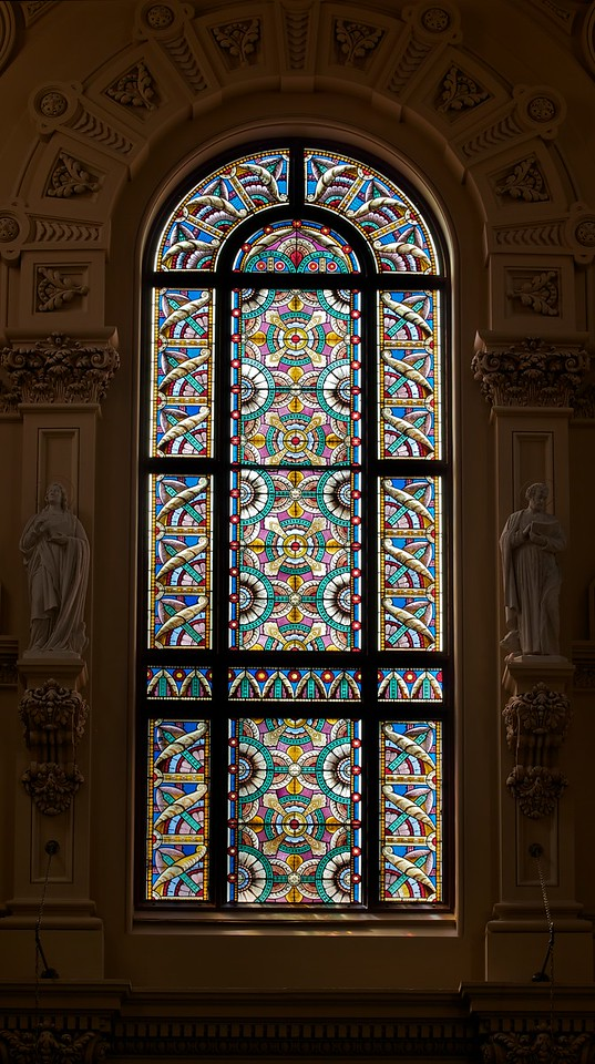 "The Church of Saint Francis Xavier Stained Glass Window <br><br> From the <a href=""http://www.sfxavier.org/wordpress/wp-content/uploads/downloads/2013/02/Entire-Tour-Guide-Reduced.pdf "">Church of St. Francis Xavier Tour Guide</a> available at the church website and at the church entrance: <br><br> ""There are no figural elements in the stained glass (unique to a Catholic church of this era). Typical late 19th century American decorative style of geometric shapes and quilting patterns and the abundance of flora found in the U.S. were used by the architect, Patrick Keely, to pay homage to his new American home."""