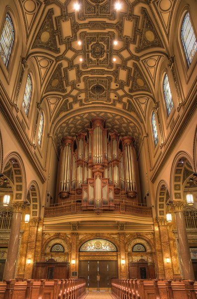 """The Church of Saint Ignatius Loyola Mander Organ <br><br> The organ at Saint Ignatius Loyola is from N.P. Mander of London and is New York City's largest mechanical action (tracker) pipe organ and is the largest mechanical action pipe organ ever to have been built in the British Isles according to <a href=""""http://www.stignatiusloyola.org/index.php/about_us/church_history_tour """">the church website. </a> The organ contains over 5,000 pipes and weighs approximately 30 tons (67,000 pounds).   From the <a href=""""http://www.mander-organs.com/leader.html"""">Mander website:</a> <br><br> """"The 68-stop four manual and pedal organ in the Church of St Ignatius Loyola, New York is the largest mechanical action ever to have been built by a British builder. It stands some 44 feet tall on the west gallery of this fine Manhattan church and took almost two years to build and install. This instrument embodies all the principles of excellence which are the hallmark of a Mander Organ. Based on the French Romantic organ of the mid nineteenth century, it has proved to have exceptional versatility. The case is an original design and is built of French oak from trees planted about the time of the Revolution. The sensitive suspended key action which employs purely mechanical couplers has delighted many organists. <br><br> After playing a concert, André Isoir wrote  <br><br> I have played with the greatest pleasure the Mander of St Ignatius. Perfection in the building, incredible action, and above all, distinction in the voicing: this instrument is for me the most perfect medium.  <br><br> High praise indeed from one who has played and recorded on numerous organs in the course of his long and distinguished career. This achievement has established Mander firmly at the forefront of organ building at the turn of the Millennium. <br><br> A masterpiece! An inspiration for the organist. The words of Prof. Ernst-Erich Stender, organist at Buxtehude's church, the Marienkirche in Lübeck  <br><br> Very soo"""