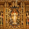 The Saint James' Reredos<br /> <br /> Ralph Adams Cram designed the great reredos above the main altar and was carved in Boston by the firm of Irving and Casson. The polychromed figures depict Christ and many great disciples and followers, including early Christians and historic leaders of the Anglican Church. The risen CHRIST IN GLORY, at the center of the reredos, is surrounded with symbols of the four evangelists. At Christ's feet are adoring angels and the tree of life, symbolizing the resurrection and eternal life. At the extreme left (facing the image) is Saint James the Great and at the extreme right is Saint Paul. The small figure to the above left of Christ is Irenaeus; above right is Richard Hooker (Anglican priest and an influential theologian who exerted a lasting influence on the development of the Church of England); lower left is Gregory of Nazianzus; and lower right is Clement.