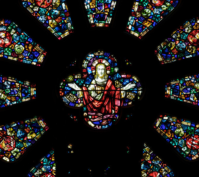 "Saint James' Church Rose Window <br><br> Guthrie Studios of New York designed the rose window positioned above the grand organ. Christ is in the center. <br><br> John Gordon Guthrie (1874–1961), a Scottish immigrant, known professionally as ""J. Gordon Guthrie"" designed the rose window. Guthrie had first designed windows for Tiffany Studios. He left Tiffany in 1906 and worked for Duffner & Kimberly until 1914. The New York City company produced leaded glass and bronze lamps at approximately the same time as Tiffany. He then worked with Henry Wynd Young (1874–1923) until Young's death in 1923, when Guthrie took over the management of Young's studio. Guthrie began his own firm in 1925, and was active as a stained glass designer until his death on June 23, 1961, according to <a href=""http://en.wikipedia.org/wiki/Duffner_and_Kimberly "">Wikipedia.</a>"
