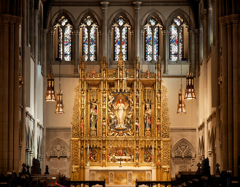 "Saint James' Church Reredos<br /> <br /> ""The great reredos above the main altar was designed by Ralph Adams Cram and carved in Boston by the firm of Irving and Casson. The polychromed figures depict Christ and many great disciples and followers, including early Christians and historic leaders of the Anglican Church. The risen CHRIST IN GLORY, at the center of the reredos, is surrounded with symbols of the four evangelists. At Christ's feet are adoring angels and the tree of life, symbolizing the resurrection and eternal life. St. James the Great (the patron saint of the parish) and St. Paul are shown at Christ's right and left. Twelve scholars of the church are arranged in four columns. The three lower panels below the main altar piece serve as a prologue to the risnen Christ above. The center panel is a dramatic rendition of the Last Supper. In the left panel, Christ calls James and John to follow him, while Zebedee calmly mends to his nets. In the right panel Saul, blinded, travels the road to Damascus on his way to become St. Paul."""