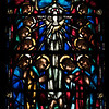 """Saint James' Church Stained Glass Window by Charles Connick <br><br> The south window was designed by Charles Connick and depicts scenes of Christ's life with the apostles. I love to deep, rich blue, purple, and red colors in the window. This panel reads """"He That Receiveth You Receiveth Me."""" <br><br> Connick (1875-1945) produced most of the spectacular stained glass windows in the church. Connick was a prominent artist best known for his work in stained glass in the Gothic Revival style. He was born in Crawford Country, Pennsylvania and developed an interest in drawing at an early age. He left high school when his father became disabled to become an illustrator on the staff of the Pittsburgh Press. At the age of 19, he learned the art of stained glass as an apprentice in the shop of Rudy Brothers in Pittsburgh, where he stayed through 1899. He worked for a number of stained glass companies in Pittsburgh and New York. He went to England and France to study ancient and modern stained glass, including those in the Chartres Cathedral. His first major work was First Baptist Church in Pittsburgh in 1912.  <br><br> Connick settled in Boston opening a stained glass studio in Back Bay in 1913; the Charles J. Connick Associates Studio continued to operate after his death until 1986. He produced many notable windows in such churches as Saint Patrick's Cathedral, Saint John the Divine, the Princeton University Chapel, and Saint Vincent Ferrer. According to Wikipedia, the Charles J. Connick Associates Studio produced some 15,000 windows in more than 5,000 churches and public buildings. <br><br> According to <a href=""""http://en.wikipedia.org/wiki/Charles_Connick"""">Wikipedia, </a> """"Connick preferred to use clear """"antique"""" glass, similar to that of the Middle Ages and praised this type of glass as """"colored radiance, with the lustre, intensity, and baffling vibrant quality of dancing lights."""" He employed a technique of """"staggered"""" solder-joints in his leading and bars, which English s"""