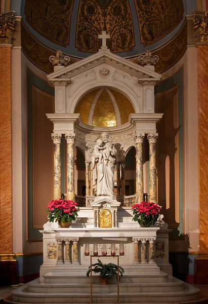 """Altar of Saint Joseph <br><br> From the<a href=""""http://stjeanbaptisteny.org/History/Architectural-Tour""""> Saint Jean Baptiste website,</a> number 13-16: <br><br> The statue at the Altar of Saint Joseph is also of Carrara marble and is believed to be of the same provenance as the statue of Our Lady.  In a very subtle fashion, the infant Jesus points to Saint Joseph, while Joseph, with his left hand, simultaneously holds a stem of lilies and points to his foster son."""