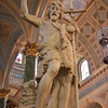 "Saint John the Baptist Statue <br><br> From the<a href=""http://stjeanbaptisteny.org/History/Architectural-Tour""> Saint Jean Baptiste website,</a> number 3: <br><br> ""Upon entering the main body of the church from 76th Street, one is immediately greeted by an imposing statue of the parish patron, the prophet John the Baptist. Possibly the finest sculpture in the building, it was moved to its present location from the lower church (now the Saint Jean Baptiste Community Center). The Baptist is clothed in camel's hair and holds a cruciform staff, with a lamb at his feet. John called Jesus the ""Lamb of God who takes away the sin of the world"" (John 1:29)."""