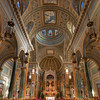 "Saint Jean Baptiste Catholic Church Nave and High Altar <br><br> This is a panorama resulting from two stitched photos in Photoshop Elements. I used an HDR processes on both and laid the HDR version on top of the properly exposed version in Photoshop. I then adjusted the opacity slider to achieve the desired result.  <br><br> From the<a href=""http://stjeanbaptisteny.org/History/Architectural-Tour""> Saint Jean Baptiste website,</a> number 7: <br><br> ""From any point in the church, our eyes are inevitably drawn to the high altar.  Constructed mostly of fawn-colored marble, it rises to some 50 feet, a height surpassing the cornice of the apse, with a base extending 26 feet in width. The altar was made in Italy and assembled in the church by craftsmen who came to New York for this purpose."""