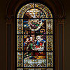 "Saint Jean Baptiste Catholic Church Stained Glass Windows by Charles Lorin <br><br> From the<a href=""http://stjeanbaptisteny.org/History/Architectural-Tour""> Saint Jean Baptiste website,</a> number 4: <br><br> ""Saint Jean Baptiste features several sets of stained glass windows.  The most important and visually dominant are the windows of the nave (including the apsidal chapels) and clerestory (second level).  These beautiful windows were designed and crafted by the Chartres, France, atelier of Charles Lorin between 1914 and 1919.  Due to the danger of shipping during World War I, they were kept in France and, therefore, not installed until 1920.  Along with the Lorin windows in Saint Patrick's Cathedral, these are the only examples in New York of the superb craftsmanship of this workshop.  <br><br> Like most of the church's decorative elements, the windows reflect the Eucharistic focus of Saint Jean Baptiste and the Congregation of the Blessed Sacrament.  The nave windows depict events in the life of Christ (mostly on the north wall) and subsequent Eucharistic events or doctrines in the life of the Catholic Church (south wall).  The clerestory windows depict Old Testament scenes that are pre-figurations of the events in the lower windows, once again with an emphasis on those that pre-figure the Eucharist.  The forms and compositions of the designs may be traced to the great tradition of French classicizing history painting, from Poussin in the seventeenth century to nineteenth-century masters such as Ingres and his followers."" <br><br> From the website of <a href=""http://sjearchives.org/history-of-the-stained-glass-windows.php"">Saint John the Evangelist Catholic Church in Green Bay, Wisconsin:</a> <br><br> ""The ""Lorin de Chartres"" Studio or Atelier Lorin was founded by Nicolas Lorin (1815 – 1882), a master of painted and stained French art glass, in 1863.  His wife, Madame Veuve Lorin and his son Charles Lorin (1874 – 1940) took over the studio upon Nicolas' death. The Lorin Studio restored medieval glass and created many stained glass windows around the world including windows in St. Patrick's Cathedral in New York, the Cathedral Notre Dame de Chartres in France, the Miracle of St. Nicolas in the Monaco Cathedral, and the Eglise Saint Jean Baptiste in New York. Today the Lorin Company is the oldest stained glass workshop in Chartres.  Chartres is noted for its stained glass designs and is the home of Centre International du Vitrail Museum dedicated to stained glass technology. <br><br> Jacques-Louis David and Jean-August Ingres, two important French neo-classical painters who weren't known for their religious works, influenced Nicolas and Charles Lorin but the inspiration might have come from their style. Charles Alexandre Crauk, a painter of religious and historical paintings and head of the Lorin drawing studio, was also influenced by the neoclassical style. The neoclassical artists were known for an artistic style that emphasized symmetry, austerity, clean lines, a revival of the classical themes of history and mythology, attention to detail, bold figures in sharp vibrant colors, and a quest for beauty.  The neoclassical paintings had clear, bold outlines against pastel or darker back grounds, enhancing the important figures or groups within the scene. The effects of light were not a mere accident, in most cases, light signaled vitality, darkness represented death."""