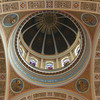 "Saint Jean Baptiste Catholic Church Dome and Vaulted Ceiling <br><br> From the<a href=""http://stjeanbaptisteny.org/History/Architectural-Tour""> Saint Jean Baptiste website,</a> number 10: <br><br> ""Rising high above the floor of the nave, the dome and the vaulted ceiling presented many challenges to the restorers in the late 1990s, not the least of which was the choice of colors.  Ultimately, fifteen colors were chosen: blues, browns, golds, greens, and purples, all derivative of the permanent features of the church. <br><br> The ceiling is adorned with six illusionistic panels that open to the sky as the realm of God.  The ornate plasterwork along the bands of the ceiling includes various symbols of the Eucharist and heavenly abundance (wheat, grapes, peacocks, and cornucopia).  Ceiling wreaths laden with fruit echo these themes.  The cornice, which wraps around the church just above the pillars, is decorated with acanthus leaves and florets and with cameo portraits of the founders of the two religious orders that serve Saint Jean Baptiste ― Saint Marguerite Bourgeoys of the Congregation of Notre Dame and Saint Peter Julian Eymard of the Congregation of the Blessed Sacrament.  Excerpts from the Latin text of Saint Thomas Aquinas' stirring Eucharistic hymn, Lauda Sion, in elegant gold lettering, encircle the seating area and the sanctuary."""