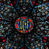 "Saint John the Divine Lesser Rose Window by Charles Connick (1933) <br><br> According to material from the church, Charles Connick designed the Great Rose Window in 1933. ""The seven points of the star are derived from the Revelation of St. John. Int the center is Our Lords Monogram, IHS, the first three letters of Jesus in Greek, surrounded by seven fountains, seven vines, seven pairs of doves, and seven stars."" <br><br> This is one of the first photos I took with a long telephoto lens, a Canon 70-200 f4 USM. My work up to that point was with much wider angle lenses, 10-22mm or 17-55mm, which provides a nice overall view of a window. However, I wanted a much closer perspective, tight enough to see the artist's detail of the work. Considering the 1.6X crop factor, this was shot at 300mm.  <br><br> Charles Connick (1875–1945) was a prominent artist best known for his work in stained glass in the Gothic Revival style. He was born in Crawford Country, Pennsylvania and developed an interest in drawing at an early age. He left high school when his father became disabled to become an illustrator on the staff of the Pittsburgh Press. At the age of 19, he learned the art of stained glass as an apprentice in the shop of Rudy Brothers in Pittsburgh, where he stayed through 1899. He worked for a number of stained glass companies in Pittsburgh and New York. He went to England and France to study ancient and modern stained glass, including those in the Chartres Cathedral. His first major work was First Baptist Church in Pittsburgh in 1912. Connick settled in Boston opening a stained glass studio in Back Bay in 1913; the Charles J. Connick Associates Studio continued to operate after his death until 1986. He produced many notable windows in such churches as Saint Patrick's Cathedral, Saint John the Divine, the Princeton University Chapel, and Saint Vincent Ferrer. According to Wikipedia, the Charles J. Connick Associates Studio produced some 15,000 windows in more than 5,000 churches and public buildings. <br><br> According to <a href=""http://en.wikipedia.org/wiki/Charles_Connick"">Wikipedia, </a> ""Connick preferred to use clear ""antique"" glass, similar to that of the Middle Ages and praised this type of glass as ""colored radiance, with the lustre, intensity, and baffling vibrant quality of dancing lights."" He employed a technique of ""staggered"" solder-joints in his leading and bars, which English stained-glass historian Peter Cormack says gives the windows their ""syncopated or 'swinging' character."" His style incorporated a strong interest in symbolism as well. Connick expressed the opinion that stained glass's first job was to serve the architectural effect and he believed that his greatest contribution to glasswork was ""rescuing it from the abysmal depth of opalescent picture windows"" of the sort popularized by Louis Comfort Tiffany and John La Farge. Although firmly committed to a regenerated handicraft tradition, Connick welcomed innovation and experimentation in design and technique among his co-workers at his studio."" <br><br> According to the <a href=""http://www.cjconnick.org/"">Charles J. Connick Stained Glass Foundation website</a> ""Using pure, intense color and strong linear design, this guild of artists led the modern revitalization of medieval stained glass craftsmanship in the United States.  Their work reflected a strong interest in symbolism in design and color, and stressed the importance of the relationship between the window's design and its surrounding architecture.  As if with one mind and one pair of hands, the craftsmen in the Connick Studio worked collectively on their windows like the 12th- and 13th- century artisans whose craft inspired them."" <br><br> The Charles J. Connick Stained Glass Foundation was formed after the studio closed in 1986. According to the <a href=""http://www.cjconnick.org/"">foundation website</a> ""The mission of the Charles J. Connick Stained Glass Foundation, Ltd. is to promote the true understanding of the glorious medium of color and light and to preserve and perpetuate the Connick tradition of stained glass."" <br><br> Here is an interesting <a href=""http://video.mit.edu/watch/charles-j-connick-and-mit-10153/"">video from the Massachusetts Institute of Technology</a> on Connick. In December 2008, the foundation donated materials to the MIT's Rotch Library of Architecture and Planning to form the Charles J. Connick Stained Glass Foundation Collection."