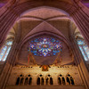 "Cathedral of Saint John the Divine Rose Window by Charles Connick <br><br> Similar to the previous photo, this is a tighter shot of the West Rose window above the front entrance. According to information from the church, Charles Connick designed the Great Rose Window at the top in 1933. It depicts Christ in Glory, surrounded by angels, beatitudes, the four evangelists (Matthew, Mark, Luke, John), the prophets (Isaiah, Jeremiah, Daniel, and Ezekiel), Divine Love, Seraphim, and Divine Wisdom: Cherubim. <br><br> Charles Connick (1875–1945) was a prominent artist best known for his work in stained glass in the Gothic Revival style. He was born in Crawford Country, Pennsylvania and developed an interest in drawing at an early age. He left high school when his father became disabled to become an illustrator on the staff of the Pittsburgh Press. At the age of 19, he learned the art of stained glass as an apprentice in the shop of Rudy Brothers in Pittsburgh, where he stayed through 1899. He worked for a number of stained glass companies in Pittsburgh and New York. He went to England and France to study ancient and modern stained glass, including those in the Chartres Cathedral. His first major work was First Baptist Church in Pittsburgh in 1912. Connick settled in Boston opening a stained glass studio in Back Bay in 1913; the Charles J. Connick Associates Studio continued to operate after his death until 1986. He produced many notable windows in such churches as Saint Patrick's Cathedral, Saint John the Divine, the Princeton University Chapel, and Saint Vincent Ferrer. According to Wikipedia, the Charles J. Connick Associates Studio produced some 15,000 windows in more than 5,000 churches and public buildings. <br><br> According to <a href=""http://en.wikipedia.org/wiki/Charles_Connick"">Wikipedia, </a> ""Connick preferred to use clear ""antique"" glass, similar to that of the Middle Ages and praised this type of glass as ""colored radiance, with the lustre, intensity, and baffling vibrant quality of dancing lights."" He employed a technique of ""staggered"" solder-joints in his leading and bars, which English stained-glass historian Peter Cormack says gives the windows their ""syncopated or 'swinging' character."" His style incorporated a strong interest in symbolism as well. Connick expressed the opinion that stained glass's first job was to serve the architectural effect and he believed that his greatest contribution to glasswork was ""rescuing it from the abysmal depth of opalescent picture windows"" of the sort popularized by Louis Comfort Tiffany and John La Farge. Although firmly committed to a regenerated handicraft tradition, Connick welcomed innovation and experimentation in design and technique among his co-workers at his studio."" <br><br> According to the <a href=""http://www.cjconnick.org/"">Charles J. Connick Stained Glass Foundation website</a> ""Using pure, intense color and strong linear design, this guild of artists led the modern revitalization of medieval stained glass craftsmanship in the United States.  Their work reflected a strong interest in symbolism in design and color, and stressed the importance of the relationship between the window's design and its surrounding architecture.  As if with one mind and one pair of hands, the craftsmen in the Connick Studio worked collectively on their windows like the 12th- and 13th- century artisans whose craft inspired them."" <br><br> The Charles J. Connick Stained Glass Foundation was formed after the studio closed in 1986. According to the <a href=""http://www.cjconnick.org/"">foundation website</a> ""The mission of the Charles J. Connick Stained Glass Foundation, Ltd. is to promote the true understanding of the glorious medium of color and light and to preserve and perpetuate the Connick tradition of stained glass."" <br><br> Here is an interesting <a href=""http://video.mit.edu/watch/charles-j-connick-and-mit-10153/"">video from the Massachusetts Institute of Technology</a> on Connick. In December 2008, the foundation donated materials to the MIT's Rotch Library of Architecture and Planning to form the Charles J. Connick Stained Glass Foundation Collection. <br><br> This was captured with a focal length of 27mm. This is an HDR combining three exposures (-2, 0, 2) ranging in duration from 2 seconds to 30 seconds at f8, 100 ISO."