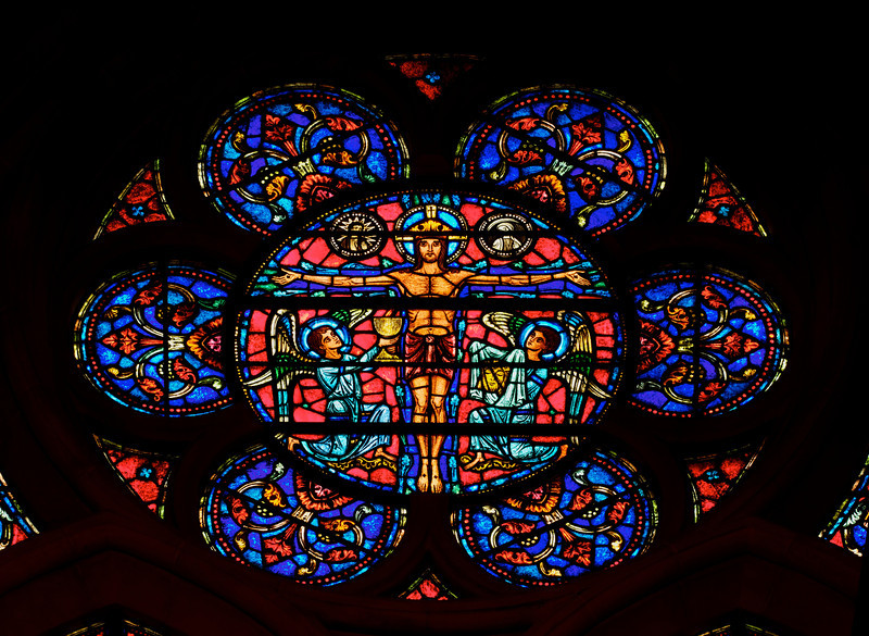 "Saint John the Divine Medical Bay Stained Glass Window by Reynolds, Francise, and Rhonstock (1936)<br /> <br /> From material from the church: ""The rosette shows the triumphant Christ on a foliated cross, with angels on either side. The lancets depict the healing miracles of Christ along with the history of medicine."" I couldn't find much information on Reynolds, Francise, and Rhonstock except that Joseph G. Reynolds worked with Connick before founding the firm in 1923."