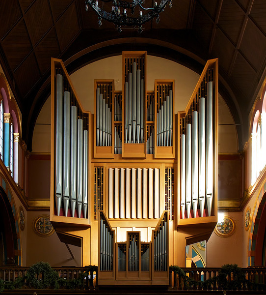 "Saint Michael's Organ from Rudolph von Beckerath Organ Company <br><br> From a pamphlet available in the narthex (entrance) of the church, ""A Brief Tour and Description of St. Michael's Church Interior and Windows,"" by church Archivist Jean Ballard Terepka: <br><br> ""The church houses two fine tracker-action organs, a smaller one in The Chapel of the Angels, and one in the north gallery (shown here), both built by the Rudolf von Beckerath Organ Company (Hamburg, Germany) in 1967. The main organ is an eclectic instrument, at home with music of all periods, but a particularly fine exponent of both German Baroque and French Classic music. The instrument has three manuals and petal with 38 stops, totaling 55 ranks. The case rises 31 feet from the rear gallery floor, with the Ruckpositiv in a separate case mounted on the gallery rail. The Beckerath firm completely cleaned and overhauled the organ during the fall 1995, but no tonal changes were made. Now in mint condition, it remains an important and successful example of the ""Orgelbewegung"" movement, and is considered by many, one of the most important instruments in the city of New York. These organs, together with the fine acrostics of the church building, feature prominently in choral and organ concerts throughout the season."" <br><br> The <a href=""http://www.beckerath.com/en/index.html"">Beckerath website</a> has photos of their organs and an interesting history of the company."