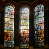 "Saint Michael's Victory in Heaven by Louis Comfort Tiffany <br><br> I summarized information on the Tiffany windows from a pamphlet available in the narthex (entrance) of the church, ""A Brief Tour and Description of St. Michael's Church Interior and Windows,"" by church Archivist Jean Ballard Terepka.  <br><br> After completion of the building in 1891, Saint Michael's rector, John Punnett Peters embarked on furnishing and decorating the church, turning to the Tiffany Glass and Decorating Company for much of the work. On Christmas Day 1895, the Tiffany windows ""Saint Michael's Victory in Heaven"" were dedicated.  <br><br> Each of the windows is five by 25 feet. The seven panels depict the victor of Saint Micheal in heaven from Revelation 12:7-12 where Satin is expelled from heaven. Saint Michael ""…the great archangel, stands on a globe among the clouds, is clothed in armor, and brandishes a sword in one hand. He bears a banner with a cross in the other hand, showing that he stands for Christ. The other archangels are Gabriel, Raphael, Uriel, Enogh, Barachiel, Jehudiel and Sealtahiel. They are surrounded by the angel hosts playing many musical instruments and singing praises to God. This window is considered the finest composition in American favrile glass,"" and was designed by Louis Comfort Tiffany.  As described by Terepka, favrile glass is an American invention from the late 19th century. In this process only the face and hands are painted. Everything else constructed of pieces of colored glass fitted into and over one another to give the proper colors, shades, and forms. Wikipedia describes it as follows: ""Favrile glass is a type of iridescent art glass designed by Louis Comfort Tiffany. It was patented in 1894 and first produced in 1896. It differs from most iridescent glasses because the color is ingrained in the glass itself, as well as having distinctive coloring. Favrile glass was used in Tiffany's stained-glass windows."""