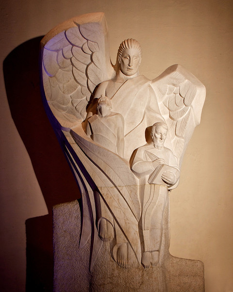 "The Angel of the Resurrection by Lumen Martin Winter, Saint Paul the Apostle Church <br><br> According to church tourist information, Lumen Martin Winter (1908-1982) executed The Angel of the Resurrection out of botticino marble in Pietrasanta, Italy. Below is the sarcophagus (not shown in the photo) of Father Isaac Hecker (1819-1888), founder of the Missionary Society of Saint Paul the Apostle (The Paulist Fathers), and first pastor of Saint Paul the Apostle. The statue shows the Angel of Resurrection enfolding Father Hecker and Saint Paul and standing vigil over the remains, which were transferred there in 1959.  <br><br> Winter was raised in Larned, Kansas near the Sante Fe Trail. Kansas landscapes and the history of the trail would later play an important role in his artwork, according to to the <a href=""http://www.kshs.org/kansapedia/lumen-martin-winter/15553"">Kansas Historical Society website.</a> Winter became a sculptor, painter, and mosaic artist, but he was most well known for his murals. <br><br> Winter attended the Cleveland School of Art and the National Academy of Design in New York City. Winter settled in 1939 in Santa Fe, working as a cartoonist and designer. He would serve as artist with the U.S. Signal Corps in the army in World War II. <br><br> In 1969 Winter was commissioned to design a mural and the official medallion for the Apollo 13 mission. Steeds of Apollo depicts four racing horses of the mythological Apollo, god of the sun, according to the website. <br><br> Winter completed a series of eight scenes depicting history, agriculture, industry, and education in the second floor rotunda of the Kansas State Capitol. Winter's murals are also displayed at the U.S. Air Force Academy Chapels in Colorado Springs, National Wildlife Federation in Washington, D.C., and the AFL-CIO headquarters."