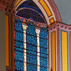 "Stained Glass Window Above the Altar by John LaFarge  LaFarge also did the windows that line the upper part of the church and the lancet windows in the choir loft. <br><br> John LaFarge (1835-1910) was an American painter, muralist, and stained glass window maker. He was born in New York City. Initially intending to study law, he changed his mind after visiting Paris in 1856. He studied with Thomas Couture. Another of Couture's students was Edouard Manet. See Couture's frescoes of the Virgin Mary in my gallery on Saint-Eustache. According to to <a href=""http://en.wikipedia.org/wiki/John_LaFarge"">Wikipedia, </a> LaFarge's earliest drawings and landscapes in Newport, Rhode Island (where he studied with painter William Morris Hunt) show originality, especially in the handling of color values.  <br><br> His first work in mural painting was in the Trinity Church in Boston in 1873. Aside from Saint Paul the Apostle, his other church works include the large altarpiece at the Church of the Ascension and Saint Paul's Chapel at Columbia University. He created four great lunettes (a half-moon shaped space) representing the history of law at the Minnesota State Capital and a similar series based on the theme of Justice for the State Supreme Court building in Baltimore, Maryland.  <br><br> He was a pioneer in the study of Japanese art.  ""LaFarge made extensive travels in Asia and the South Pacific, which inspired his painting. He visited Japan in 1886, and the South Seas in 1890 and 1891, in particular spending time and absorbing the culture of Tahiti. Henry Adams accompanied him on these trips as a travel companion. He visited Hawaii in September of 1890, where he painted scenic spots on Oahu and traveled to the Island of Hawaii to paint an active volcano. He learned several languages (ancient and modern), and was erudite in literature and art; by his cultured personality and reflective conversation, he influenced many other people. Though naturally a questioner, he venerated the traditions of religious art, and preserved his Catholic faith,"" according to Wikipedia. Also from Wikipedia, ""LaFarge experimented with color problems, especially in the medium of stained glass. He rivaled the beauty of medieval windows and added new resources by inventing opalescent glass and by his original methods of superimposing and welding his materials.""  LaFarge received the Cross of the Legion of Honor from the French Government."