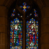 "Meekness and Faith (1930) Stained Glass Window by James Humphries Hogan of James Powell & Sons (Whitefriars), Ltd. <br><br> This window is in the Chantry Chapel also known as The Lady Chapel, which is dedicated to Our Lady, Saint Mary the Virgin. There are four windows in the chapel-all in honor of women in the Scriptures. One window was completed in 1929 and the other three in 1930. This window is Meekness and Faith, which is furthest from the altar. On the left side, which represents Meekness, is Saint Helena and Saint Elizabeth of Hungary represents Faith on the right side. The four windows were made possible by donations from the Burden family. The left window says ""The Glory of God and in Memory of"" and the right hand side ""Alice Twombly Burden Born 3 Jan. 1905 Died Feb. 6 1905"". Thanks to  David Daniel at Saint Thomas for information on the windows. <br><br> James Humphries Hogan (1883-1948) designed stained glass windows at Saint Thomas including this wondow. He was a noted stained glass artist for James Powell & Sons (Whitefriars), Ltd. of London from age 14 until his death in 1948. He made windows for many of England's churches including the 100 foot high central windows of Liverpool Cathedral. Some consider the windows at Saint Thomas to be some of the finest designs. <br><br> The firm of James Powell and Sons, also known as Whitefriars Glass, was an English glassmaker and stained glass window manufacturer. The company started in the 17th century but became well known as a result of the 19th century Gothic Revival. In 1962 the company name was changed back to Whitefriars Glass Ltd. It specialized in freeform glass ware until Caithness Glass purchased the firm in 1981. See <a href=""http://en.wikipedia.org/wiki/James_Humphries_Hogan"">Wikpedia</a> for more detail.  <br><br> In 2007, conservation began on the windows. It required three years and $20 million to restore the 9 million pieces of glass. The largest windows each required 4,500 man hours, the labor of one artisan for two and a half years. See the <a href=""http://www.saintthomaschurch.org/about/glass"">Saint Thomas website</a> and <a href=""http://www.nytimes.com/2008/04/15/arts/design/15stai.html?_r=1&ref=arts&oref=slogin"">a New York Times article</a> for more detail."