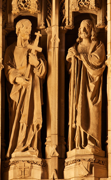 "Saint Thomas Church Reredos Statue of Saint Bartholomew and Saint Philip Shaped by Lee Lawrie<br /> <br /> It is difficult to make out details of the spectacular Saint Thomas Church reredos, even from the closest pews. To provide more detail, I used a telephoto lens at 320 mm to capture the great detail of the statues. This is Saint Bartholomew on the left and Saint Philip on the right.<br /> <br /> Bertram Grosvenor Goodhue was responsible for the theme and figures and won the American Institute of Architects' gold medal in 1925 for this effort. Sculptor Lee Lawrie shaped the figures' appearances, reflecting the individual personalities. Goodhue designed the church with Ralph Adams Cram. The carvings were executed in Boston from Dunville stone from Downsville, Wisconsin. When illuminated, the stone assumes the cast of ivory, according to ""A Walking Tour of Saint Thomas Church."""