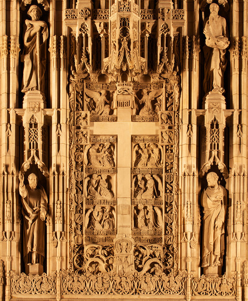 "Saint Thomas Reredos by Bertram Goodhue, Figures Shaped by Lee Lawrie<br /> <br /> Bertram Grosvenor Goodhue was responsible for the theme and figures and won the American Institute of Architects' gold medal in 1925 for this effort. Sculptor Lee Lawrie shaped the figures' appearances, reflecting the individual personalities. Goodhue designed the church with Ralph Adams Cram. The carvings were executed in Boston and depict the 12 Apostles, nine Hebrew prophets, Mary, John, and Christ, among others. The figure to the lower left hand corner is Saint Paul, Apostle to the Gentiles, lower right is Saint Peter, upper left, Saint James the Great, and upper right, Saint Andrew.<br /> <br /> The carvings are from Dunville stone from Downsville, Wisconsin. When illuminated, the stone assumes the cast of ivory, according to ""A Walking Tour of Saint Thomas Church."""